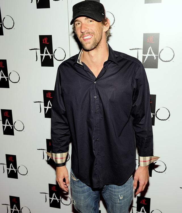 Michael Phelps took to Vegas for a little R&R with friends, who included Jamie Foxx, football players Eddie George and Michael Irvin, and former girlfriend Nicole Johnson.  The swimming star spent Friday night at Lavo and Saturday night at Tao Beach where he danced in the DJ booth and jumped in the pool.  No matter where he goes, he seems to return to his natural element.