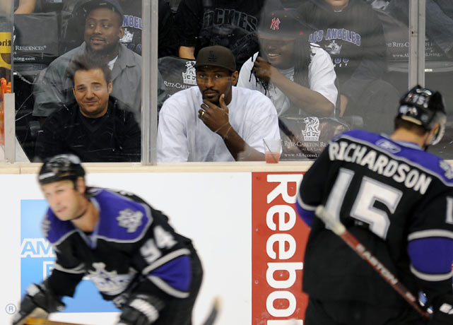 Artest watches as Ryan Smyth  and Brad Richardson of the Los Angeles Kings skate by during a game against the Phoenix Coyotes at Staples Center.