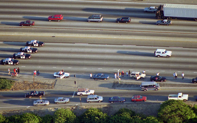 On June 17, 1994, in one of the most memorable events in modern history, O.J. Simpson led police on a 50-mile, low-speed chase down Interstate 405 in Los Angeles. Simpson, who was accused of double-murder, was a passenger in a white Ford Bronco driven by former teammate Al Cowlings. The chase, which was watched by a reported 95 million viewers, finally ended when Simpson returned to his Brentwood home. Here are some scenes from that unforgettable day.