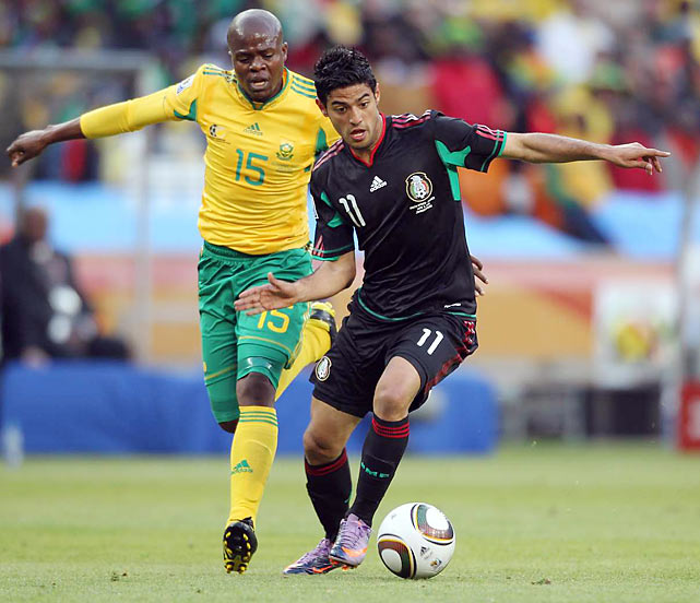 Seen here dribbling upfield, Mexican forward Carlos Vela was in the middle of the most controversial call of the match. Off a corner kick, Vela tapped the ball in for what appeared to be the World Cup's opening goal, but it was disallowed because Vela was ruled offside.