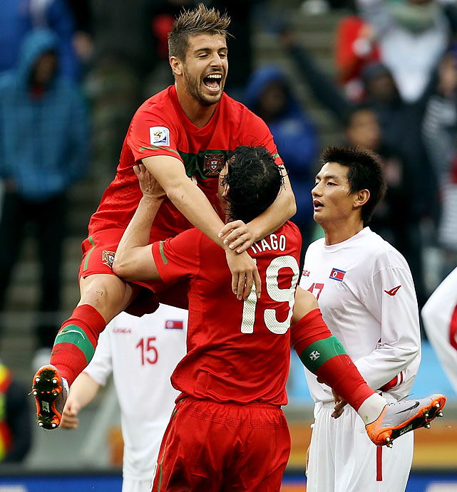 Tiago, shown here celebrating with Miguel Veloso, was the only Portugal player to score twice.