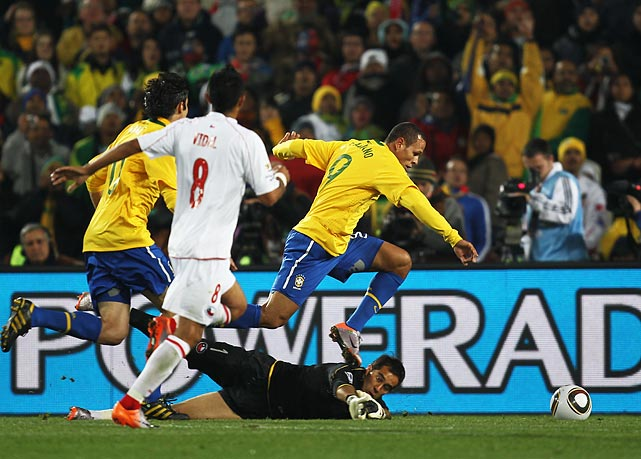 Just three minutes later, Brazil poured it on with a goal from striker Luis Fabiano. After a one-touch pass from Kaka, Fabiano scored his third goal of the tournament, stepping around Chile goalkeeper Claudio Bravo before angling the ball into the net.