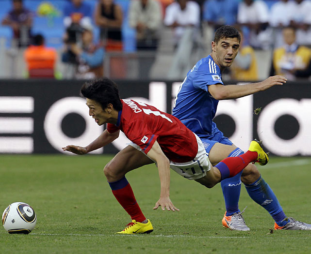 South Korea's Lee Chung-Yong battles for the ball during its pool-play opener.