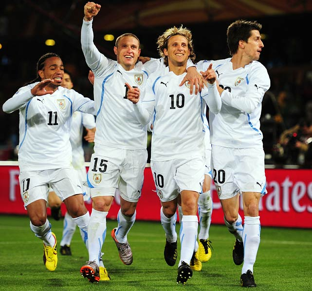 Diego Forlan (10) scored once in each half to lead Uruguay past South Africa, which is in danger of becoming the first host nation in tournament history to be eliminated in the group stage.