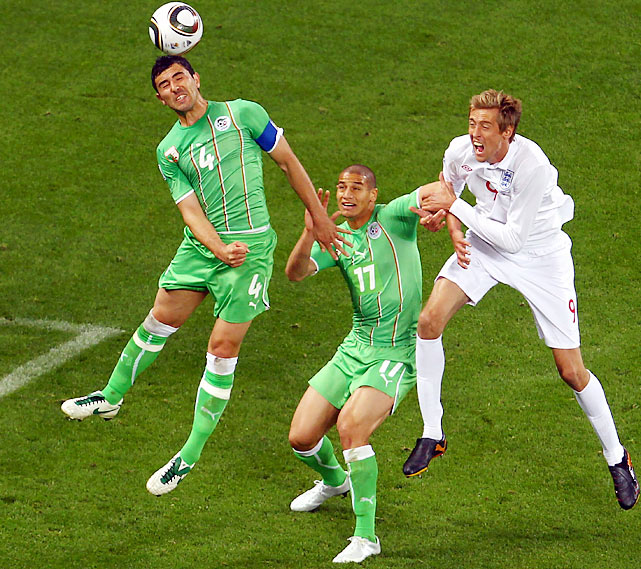 England's Peter Crouch (right) was subbed on in the 83rd minute but failed to provide a late-match offensive spark. England has now been held scoreless for 176 minutes.