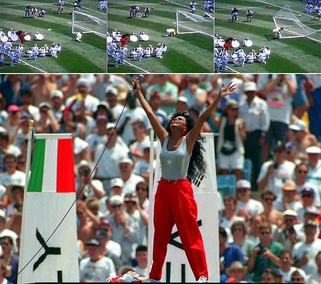 Singer/actress Diana Ross misses a penalty kick shot as the goal is rigged to fall apart when she scores, but the goal falls apart even though she misses badly.