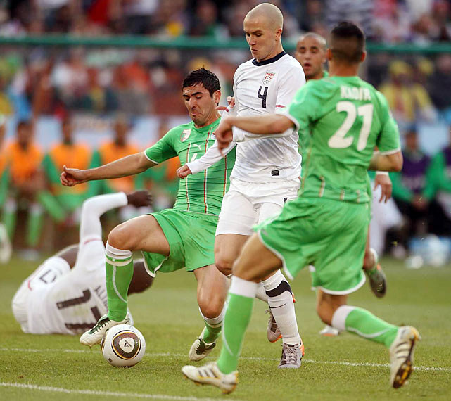 Defender Antar Yahia (left) was part of an aggressive but reckless Algerian squad that earned four bookings in the match. Yahia was sent off in extra time after earning his second yellow card of the match.