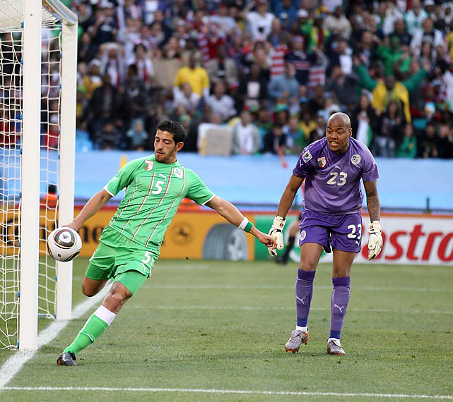 As M'Bolhi looked on, Algeria's Rafik Halliche cleared the ball near his team's goal after a late U.S. threat.