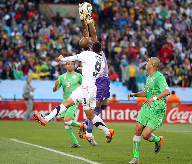 Algeria goalie Rais M'Bolhi, seen here making a leaping play on a ball intended for Herculez Gomez, was brilliant in net all day, stopping nine shots.