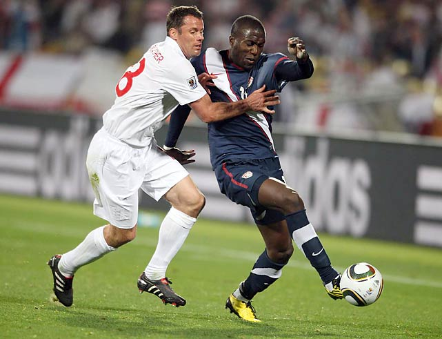 Jozy Altitdore (right) gave the U.S. a great chance to score, blasting by Jamie Carragher, but his shot in the 64th minute glanced off goalie Robert Green and hit the post.