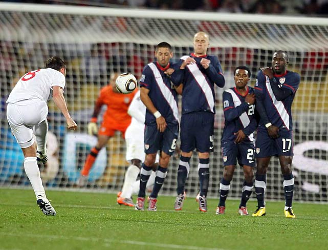 The U.S. four-man wedge (from left, (Clint Dempsey, Michael Bradley, Robbie Findley and Jozy Altidore) helped foil this England free kick.