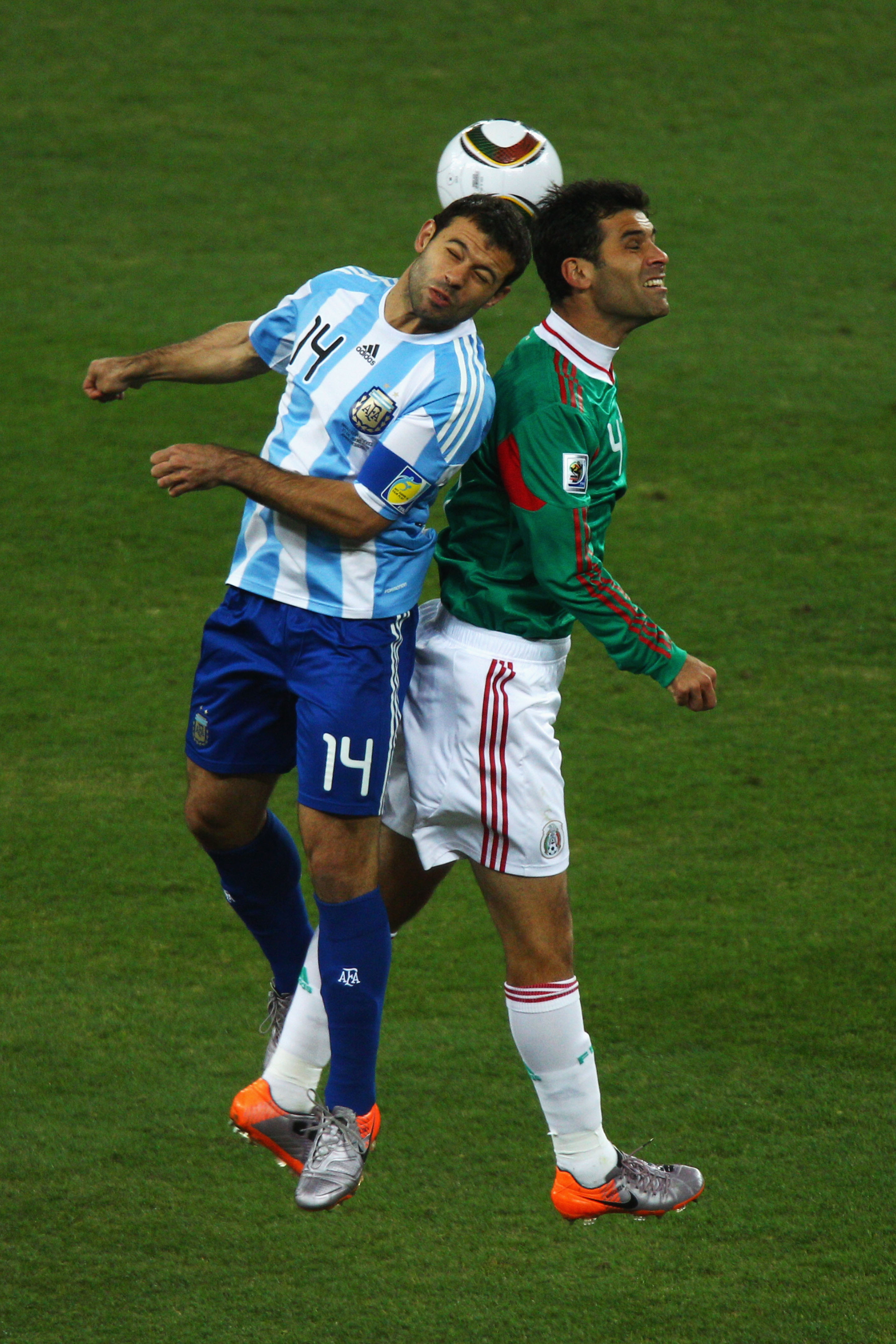 "Captains Javier Mascherano (left) and Rafael Marquez battle for the ball. Mascherano is a favorite of Maradona, who said when asked of his lineup going into the World Cup, """"Mascherano and 10 other guys."""