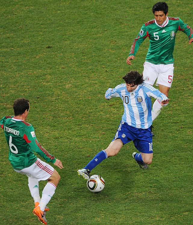 Argentina phenom Lionel Messi dribbles past Mexico's Gerardo Torrado. Messi is still scoreless in the World Cup, but he's been creating chances for teammates in each game.