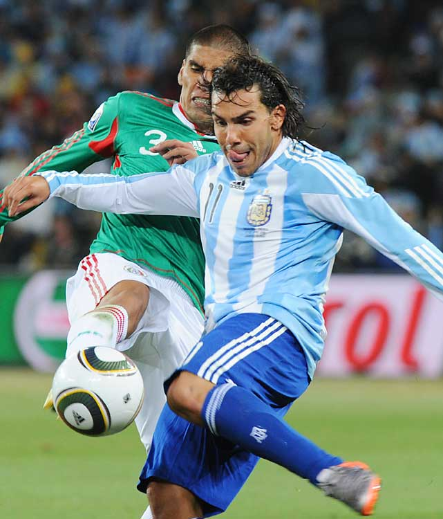 Mexico's Carlos Salcido and Argentina's Carlos Tevez fight for the ball in their round of 16 match. Tevez scored twice for Argentina.