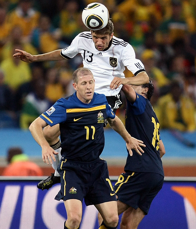 Thomas Mueller (center) not only scored a 66th-minute goal, he also had the upper hand in this exchange with Australia's Scott Chipperfield (left) and Richard Garcia.