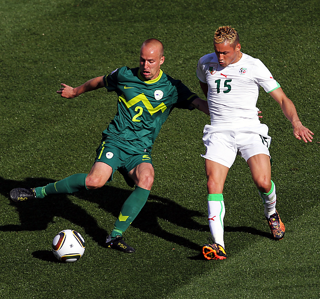 Slovenia's Miso Brecko (left) and Algeria's Karim Ziani vie for the ball. Slovenia, the World Cup's smallest nation (population 2 million, about the size of Houston) jumped over the United States and England into the Group C lead. The next Group C matches are Friday, with the U.S. facing Slovenia and England taking on Algeria.