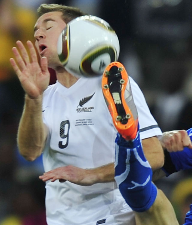Italy's defender Gianluca Zambrotta (right) kicks the ball past New Zealand's striker Shane Smeltz. Smeltz scored New Zealand's goal in a memorable result for the nation.