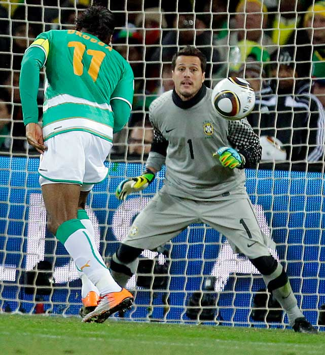 Ivory Coast superstar Didier Drogba scores against Brazil keeper Julio Cesar. Drogba (broken arm) was making his first start of the 2010 World Cup.