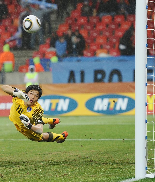 South Korean goalkeeper Jung Sung-Ryong makes a futile attempt to stop Suarez's second goal. South Korea made it to the knockout round for the second time in the last three World Cups.