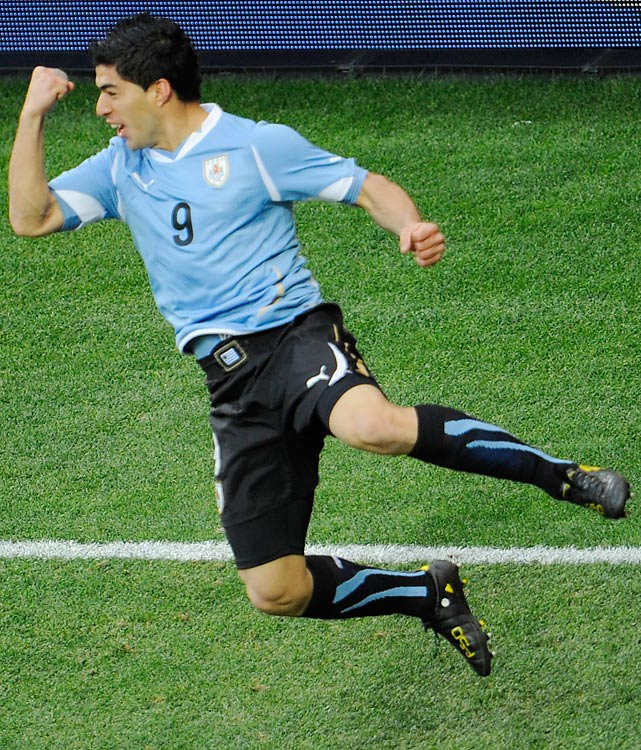 Uruguay's striker Luis Suarez celebrates after scoring the first goal. Suarez leads his country with three goals in four games.