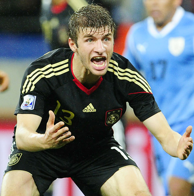 German midfielder Thomas Mueller scored the game's first goal in the 18th minute, his fifth of the World Cup. Mueller is tied with Holland's Wesley Sneijder, Spain's David Villa and Uruguay's Diego Forlan for the Golden Boot lead with one match to go.