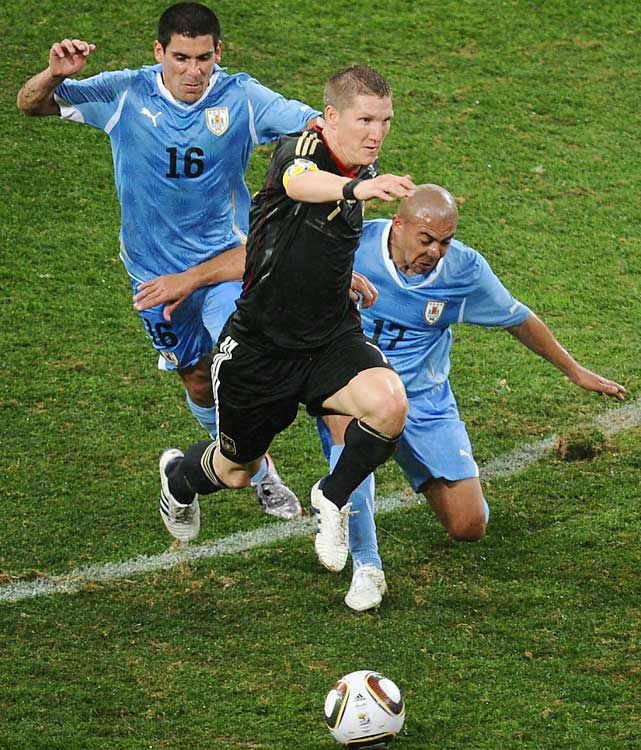 Uruguay's Maximiliano Pereira and Egidio Arevalo flank German midfielder Bastian Schweinsteiger. Germany's relentless midfield was led by Schweinsteiger during its remarkable run.