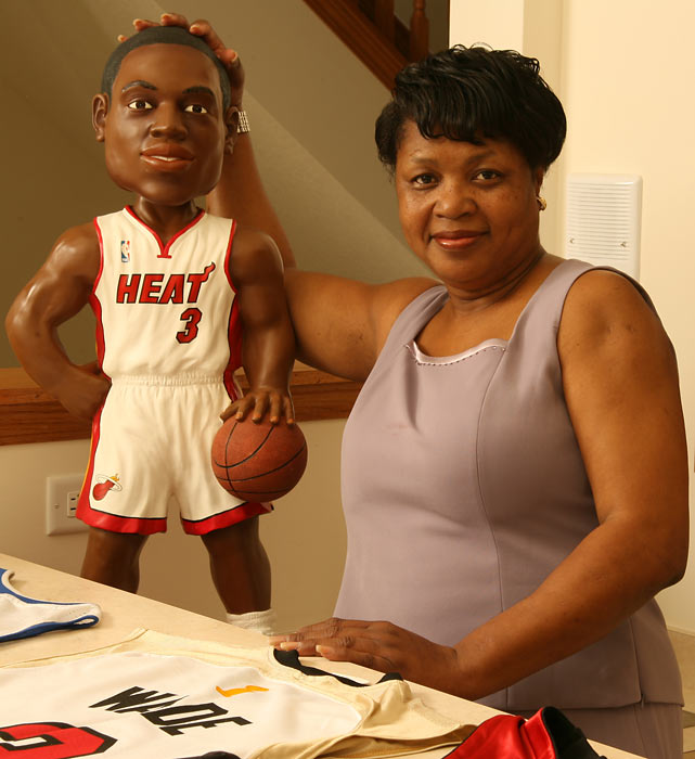Jolinda Wade shows off a bobblehead of her son.