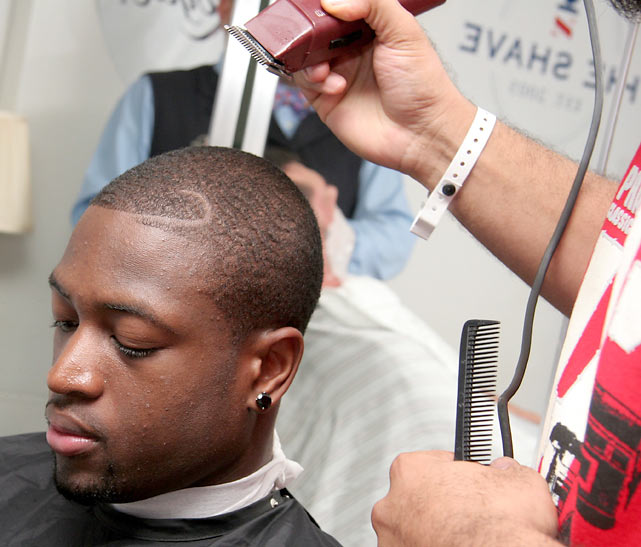 Wade takes some time from  his busy schedule to visit the barber.