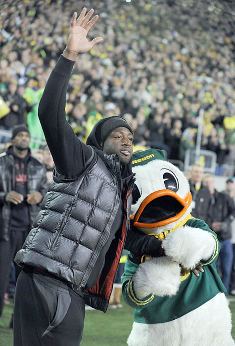 "Wade ""posts up"" The Oregon Duck before a Ducks-Trojans game in Eugene."