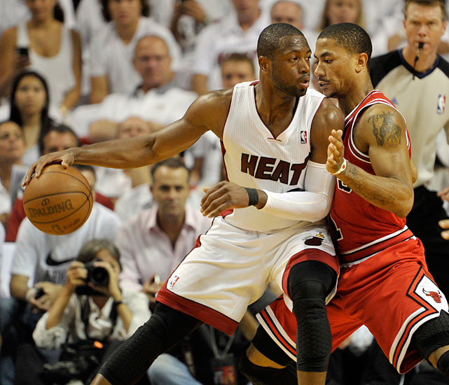 Wade tries to make a move on Bulls guard Derrick Rose during Game 4 of the 2011 Eastern Conference Finals. The Heat won to advance to the Finals, where they lost to the Mavericks.