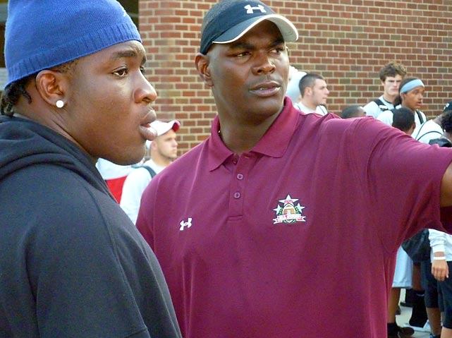 Kent Turene, a linebacker from Boyd Anderson High in Lauderdale Lakes, Fla., chats with former USC and NFL star Keyshawn Johnson, who coached the team the Express would face in the finals. After returning home from the tournament, Turene went public with his commitment to USC.