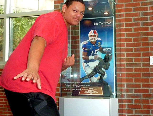 "Abraham ""Nacho"" Garcia, an offensive tackle at The University School in Davie, Fla., poses in front of Tim Tebow's Heisman Trophy while visiting Florida Field."