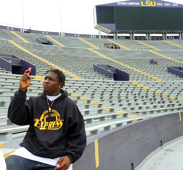 Boyd Anderson linebacker Kent Turene takes a picture of LSU's Tiger Stadium.