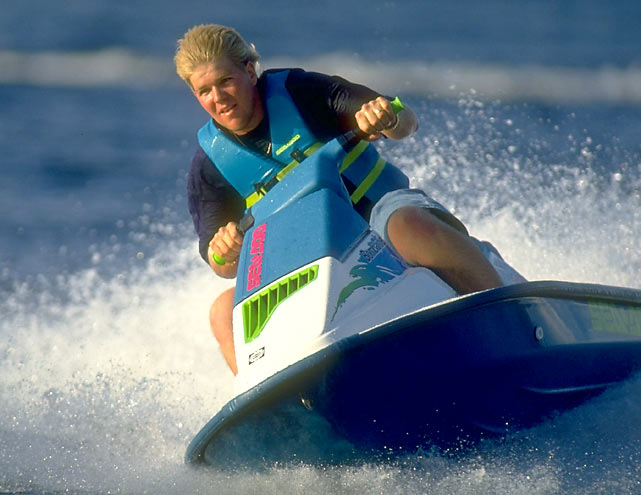 As John Daly makes headlines at St. Andrews, SI.com presents some rare photos of the controversial golfer. In this one, Daly jet skis on a lake near his Orlando home.