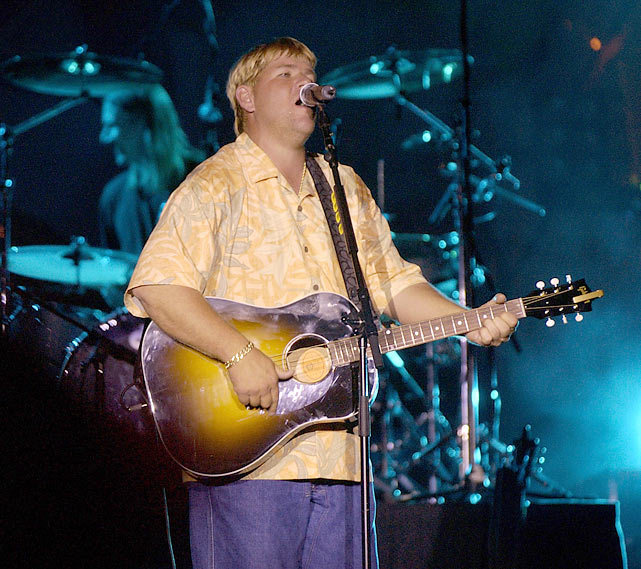 When he's not on the course, Daly unwinds with his guitar. Here he performs with Hootie and the Blowfish at Universal Studios' Mardi Gras in Orlando.