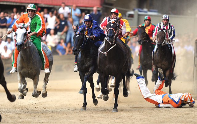Contrada of Forest jockey Silvano Mulas and his horse Fedora Saura (left) compete to win the Contrada run during the Palio in Siena. The annual race pits Siena's 17 neighborhoods against one another with a banner adorned with a picture of the Virgin Mary at stake.