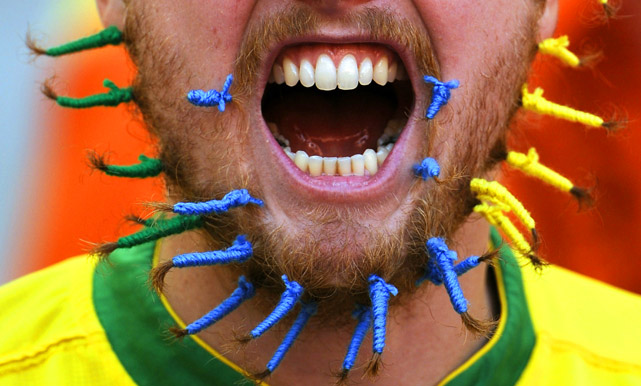 A Brazil fan, wearing the national colors on his beard, awaits the start of the World Cup quarterfinal between the Netherlands and Brazil on July 2 in Port Elizabeth, South Africa. The Netherlands defeated Brazil 2-1.