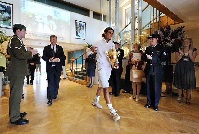 Stewards and members of the All England Lawn Tennis Club applaud Rafael Nadal as he left Centre Court following his straight-set victory over 12th-seeded Tomas Berdych in the Wimbledon final. It was Nadal's second Wimbledon title and his eighth Grand Slam win.