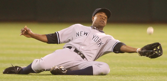New York Yankees center fielder Curtis Granderson snags a fly ball during a 3-1 win over the Oakland Athletics.