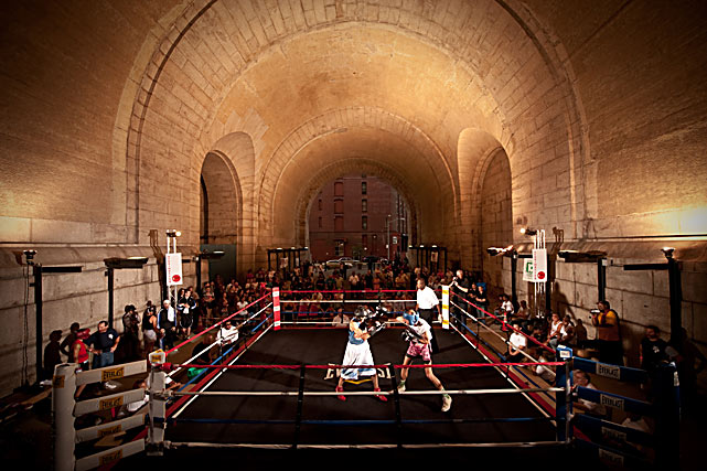 "Amateur boxers spar under the archway at Dumbo Fight Night, held in Brooklyn (under the Manhattan Bridge) on July 14. The event was sponsored by Gleason's Gym. The Underpass was closed for 17 years before reopening in 2008, trying to bring business into the ""DUMBO"" district."