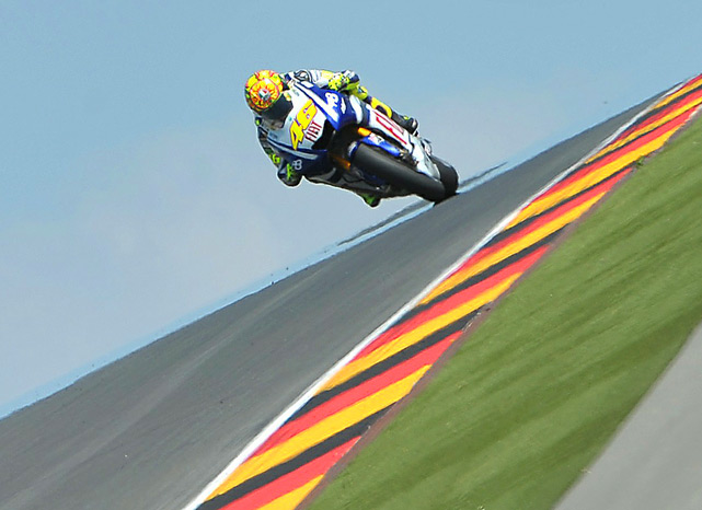 Nine-time world champion Valentino Rossi of Italy (Fiat Yamaha Team) steers his bike during the training of the Grand Prix of Germany on July 16 in Hohenstein-Ernstthal, eastern Germany. The 31-year-old Italian was given the green light to make a return to MotoGP on July 18, just 40 days after suffering a double fracture of his right leg.