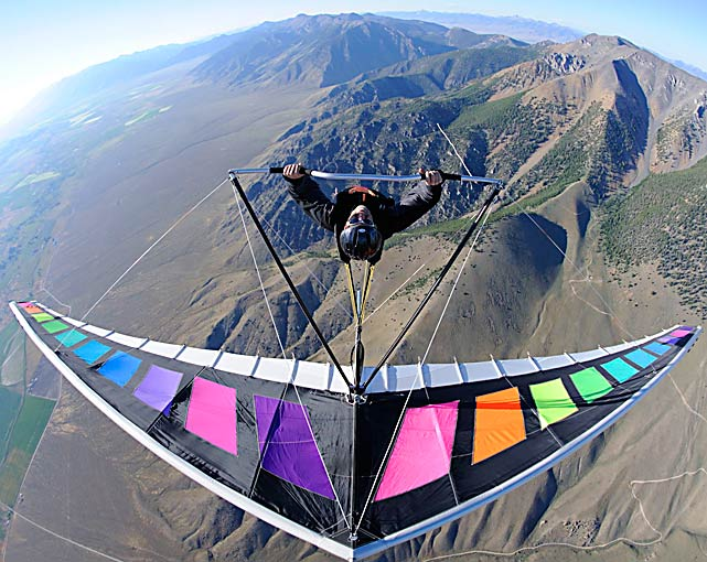 Four-time world acrobatic champion John Heiney does a loop at 8,000 feet while hang gliding July 24 at King Mountain, Idaho.