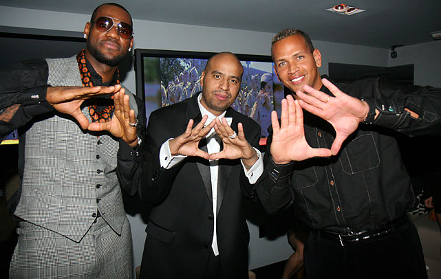 "Rodriguez strikes a ""Dynasty"" pose with LeBron James and former Roc La Familia record label president OG Juan at the Opening Night of Jay-Z's 40/40 Club in Las Vegas."