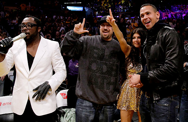 Everybody wants to be a rock superstar, even A-Rod, who is seen here watching a Lakers game in November 2009 with Cypress Hill's B-Real, and will.i.am and Fergie from the Black Eyed Peas.