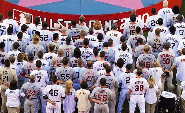 Players stood around the stage as Glee star Amber Riley sang the national anthem.