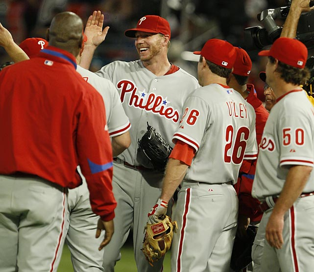Flashing an uncharacteristic smile and hugging catcher Carlos Ruiz after recording the last out of his game against the Marlins, Phillies pitcher Roy Halladay celebrated throwing the 20th perfect game in major league history -- just 20 days after Braden's. Halladay needed 115 pitches to retire the Marlins and struck out 11 on the day. After the game, he was congratulated over the phone by Vice President Joe Biden.