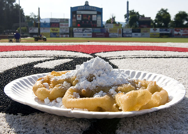 "Nothing quite exemplifies the South's penchant for tasty fried food like good ole-fashioned funnel cake. According to Lookouts rep Greg Dorris, At AT&T Field, home of the Double-A Chattanooga Lookouts, ""life can't get any better than indulging oneself with this fried dough and powdered sugar concoction."""