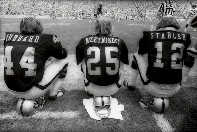Running back Marv Hubbard, wide receiver Fred Biletnikoff and quarterback Ken Stabler of the Raiders take in a preseason game against the Steelers.