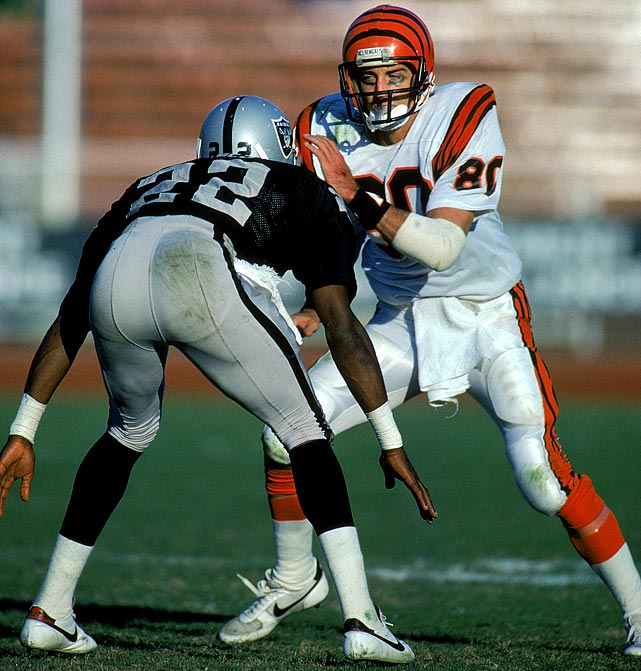 Bengals wide receiver Cris Collinsworth makes a move to get around Raiders defender Mike Haynes. Collinsworth's contract with the USFL Tampa Bay Bandits was voided that year when he failed a physical. He went on to have the third of his four 1,000-yard receiving seasons with Cincinnati.
