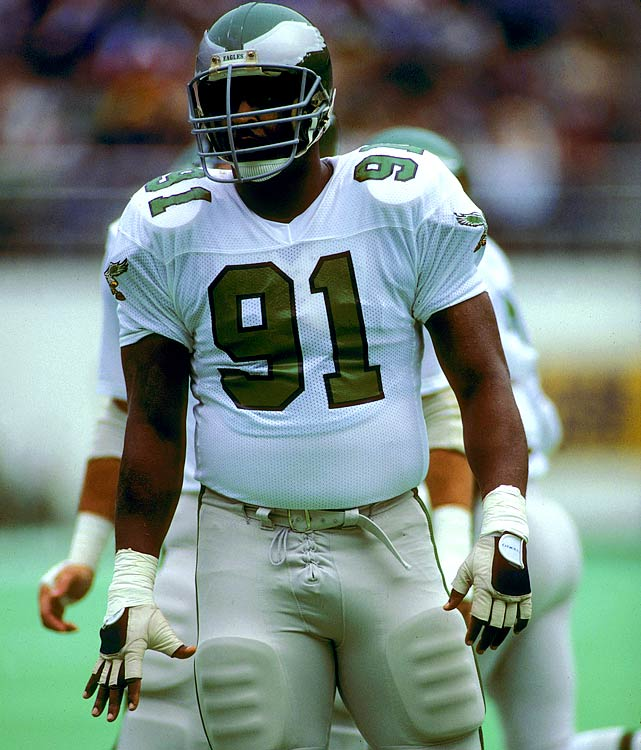 """After being taken in the 1st round of the 1984 supplemental draft, """"The Minister of Defense"""" burst onto the NFL scene in 1985 with a 13-sack rookie season for the Philadelphia Eagles. He wore No. 91 that first season because Smiley Creswell was wearing No. 92. Smiley wasn't on the '86 team and Reggie went back to No. 92. White played eight seasons in Philadelphia before adding his name to a lawsuit against the NFL that resulted in NFL players being granted free agency in 1992. He moved to Green Bay for the 1993 seasons and won Superbowl XXXII in 1997."""